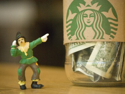 Scarecrow Pointing to Starbucks Money