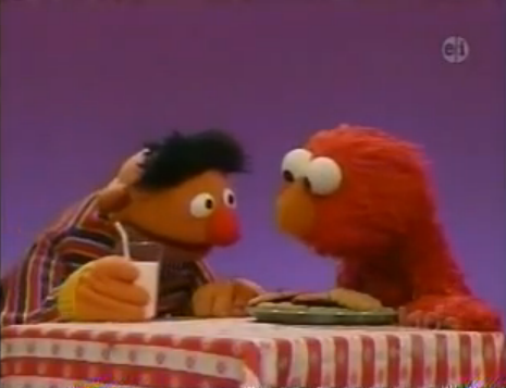 Bert and Elmo with cookie and milk