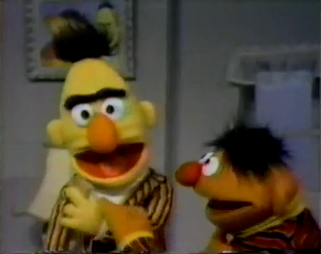 Ernie convinces Bert to share his cookie