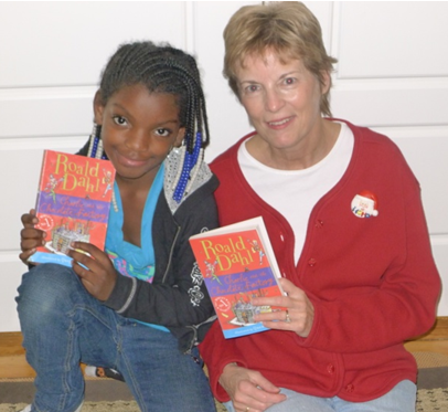 Summer Sauls and tutor Jill Wright, reading Roald Dahl's Charlie and the Chocolate Factory