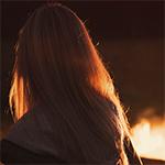 Woman near campfire