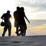 Group Trekking Through Sand