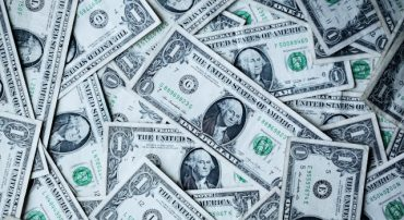 Bush Policy Taxes Wealth by Devaluing the Dollar