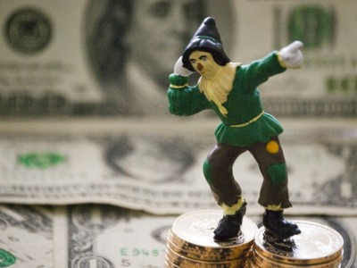 Scarecrow on Money Pointing Upwards