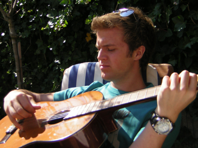 College student playing guitar